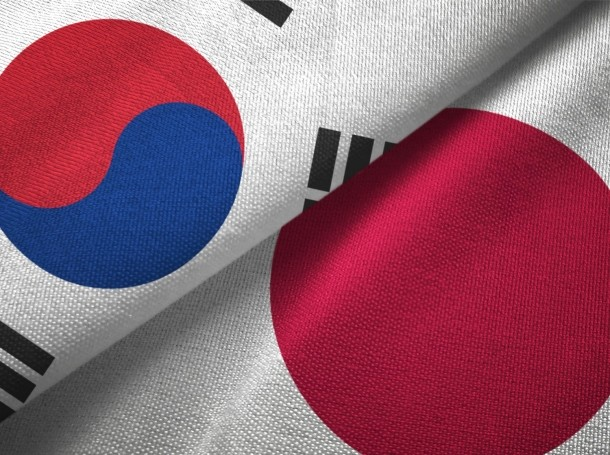 Closeup of South Korean and Japanese flags, photo by Oleksii Liskonih/Getty Images
