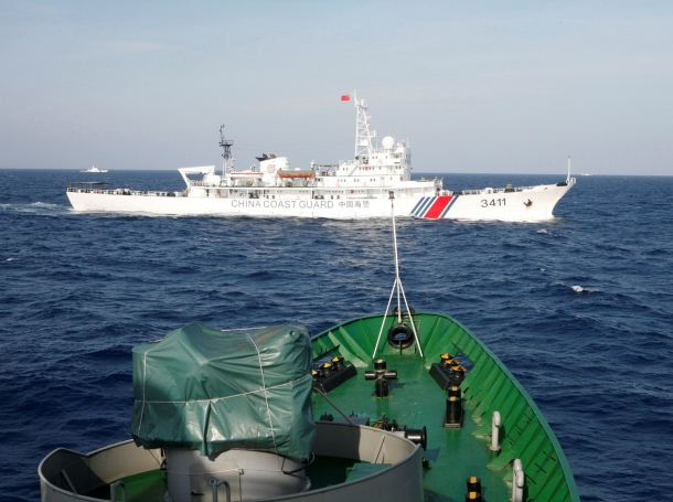 A Chinese Coast Guard ship from the bow of a Vietnam Marine Guard ship in the South China Sea, near Vietnam, May 14, 2014, photo by Nguyen Minh/Reuters