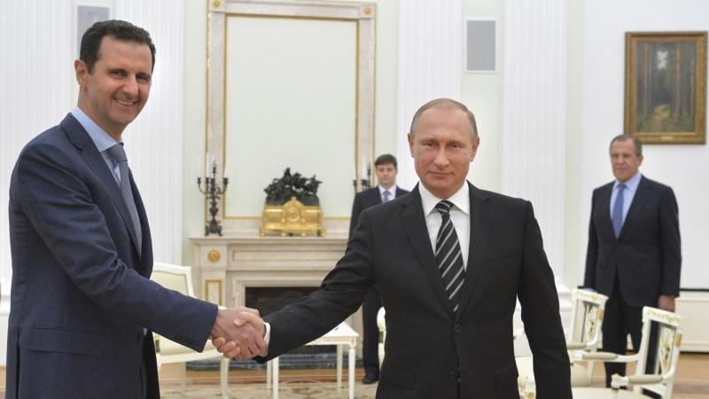 Russian President Vladimir Putin shakes hands with Syrian President Bashar al-Assad during a meeting at the Kremlin in Moscow, Russia, October 20, 2015, photo by Alexei Druzhinin/RIA Novosti/Kremlin/Reuters