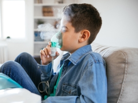 Boy using breathing treatment, photo by mixetto/Getty Images