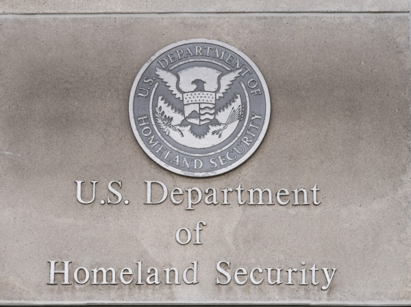 Department of Homeland Security logo on a federal building, photo by memoriesarecaptured/Getty Images
