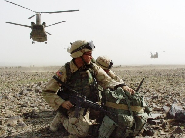 U.S. soldiers from the 82nd Airborne Division secure an area during Operation Mountain Sweep near Narizah, southeast of Kabul, Afghanistan, August 22, 2002, photo by Scott Schonauer/Stars & Stripes/Reuters