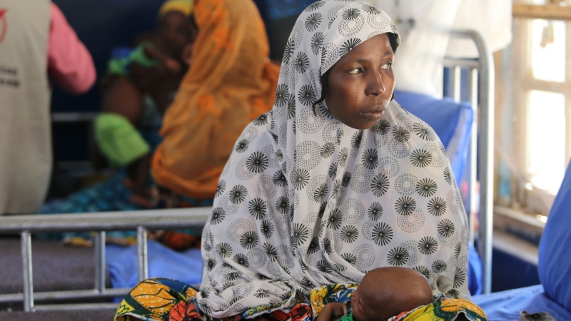 A woman holds her baby at Molai General Hospital in Maiduguri, Nigeria, November 30, 2016, photo by Afolabi Sotunde/Reuters