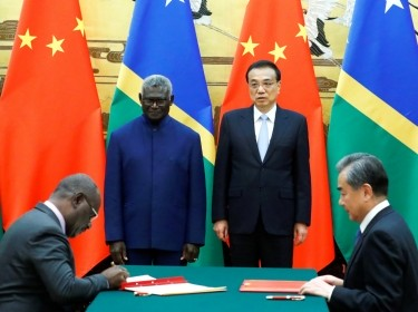 (L-R) Solomon Islands Prime Minister Manasseh Sogavare and Foreign Minister Jeremiah Manele, and Chinese Premier Li Keqiang and State Councillor and Foreign Minister Wang Yi attend a signing ceremony at the Great Hall of the People in Beijing, China, October 9, 2019, photo by Thomas Peter/Reuters