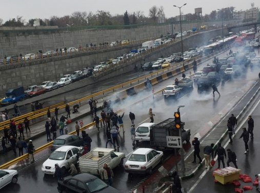 Anti-government protesters on a highway in Tehran, Iran, November 16, 2019