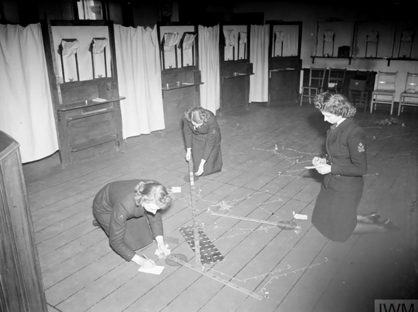 Members of the Western Approaches Tactical Unit prepare for a wargame in Derby House, Liverpool, UK, March 18, 1945, photo by Parnall, C H (Lt)/Imperial War Museums © IWM (A 27823)