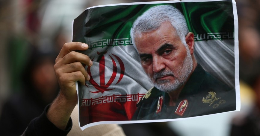 An Iranian mourner holds a picture of late General Qassem Soleimani as people gather to mourn him in Tehran, Iran, January 4, 2020, photo by Nazanin Tabatabaee/WANA (West Asia News Agency)/Reuters