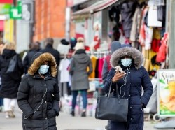 Pedestrians walk in the Chinatown district of downtown Toronto, Ontario, after 3 patients with novel coronavirus were reported in Canada January 28, 2020, photo by Carlos Osorio/Reuters