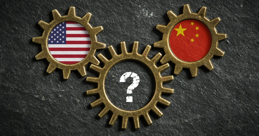 U.S. and China flags inside gears with a third gear with a question mark inside, photo by