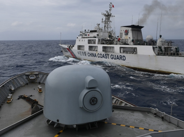 China Coast Guard ship seen from an Indonesian Naval ship during a patrol at Indonesia's Exclusive Economic Zone sea north of the Natuna Islands, Indonesia, January 11, 2020, photo by M Risyal Hidayat/Antara Foto Agency/Reuters