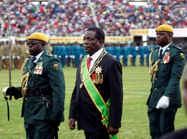 Zimbabwe's President Emmerson Mnangagwa is escorted by a guard of honour as he arrives for Independence Day celebrations in Harare, Zimbabwe, April 18, 2019, photo by Philimon Bulawayo/Reuters