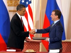 U.S. President Barack Obama and Russian President Dmitry Medvedev exchange the signed new Strategic Arms Reduction Treaty (START II) at Prague Castle in Prague, April 8, 2010, photo by Petr Josek/Reuters