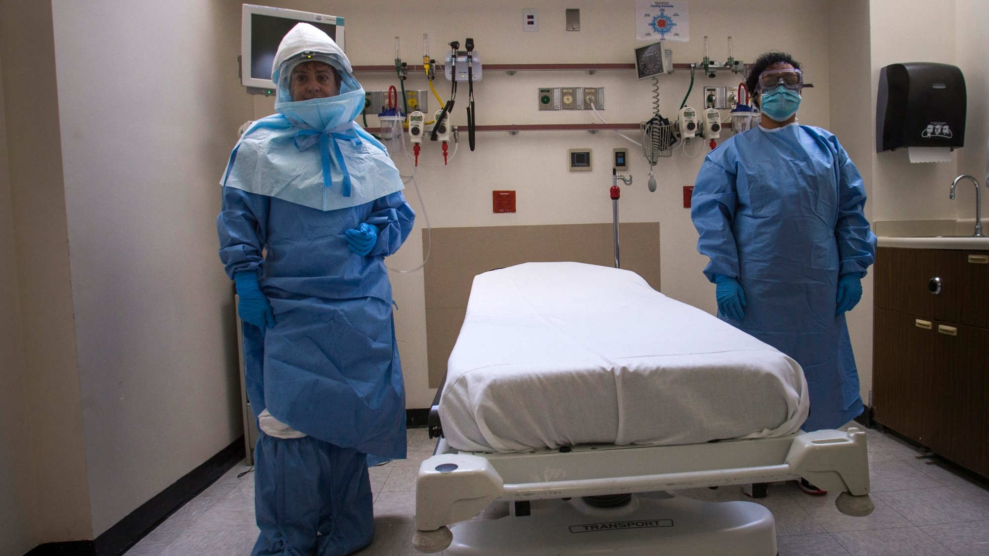 Hospital staff wear protective gear to protect them from an Ebola virus infection in the emergency department of Bellevue Hospital in Manhattan, New York, October 8, 2014, photo by Adrees Latif/Reuters