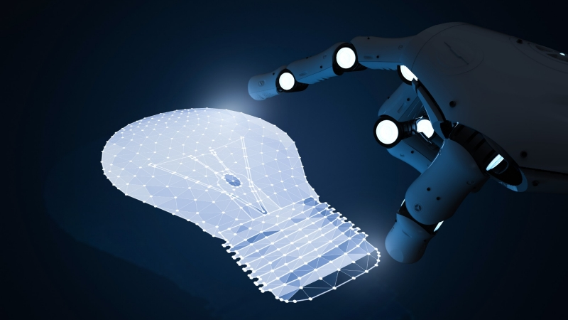 Robot hand touching CGI lightbulb, photo by PhonlamaiPhoto/Getty Images