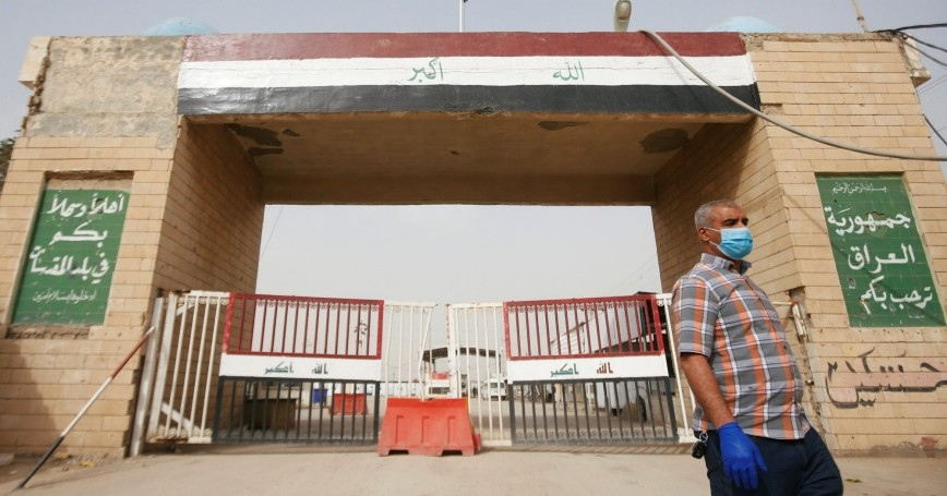 A man walks near the Shalamcha Border Crossing, after Iraq shut borders to travelers moving between Iraq and Iran, March 8, 2020, photo by Essam Al Sudani/Reuters