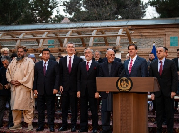NATO Secretary-General Jens Stoltenberg, President of Afghanistan Ashraf Ghani, Defense Secretary Dr. Mark T. Esper and members of the NATO, U.S., and Afghanistan delegations take a group photo at the U.S.-Afghanistan Joint Declaration Announcement at the Dilkusha Mansion Garden, Kabul, Afghanistan, Feb. 29, 2020, photo by Staff Sgt. Brandy Nicole Mejia/U.S. Army Photo