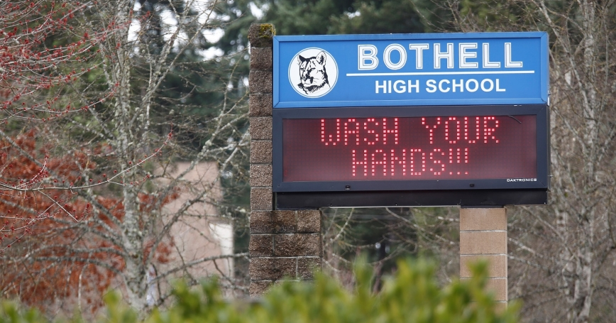 A sign in front of Bothell High School, which closed in response to the COVID-19 outbreak, reads, 'Wash your hands!!!,' Bothell, Washington State, March 3, 2020, photo by Lindsey Wasson/Reuters