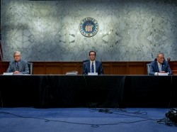 U.S. Senate Majority Leader Mitch McConnell and U.S. Senate Minority Leader Chuck Schumer meet with Treasury Secretary Steve Mnuchin to wrap up work on coronavirus economic aid legislation, Washington, D.C., March 20, 2020, photo by Mary F. Calvert/Reuters