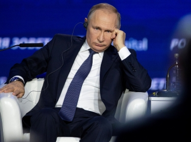 """Russian President Vladimir Putin listens to a question as he attends an annual VTB Capital """"Russia Calling!"""" Investment Forum in Moscow, Russia, November 20, 2019, photo by Alexander Zemlianichenko/Reuters"""