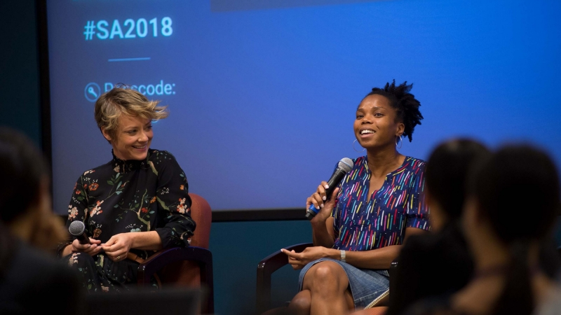 Sarah MacCarthy and Celia Gomez speaking on a panel during Summer Associates Week at RAND's Santa Monica headquarters, July-August 2018, photo by Diane Baldwin/RAND Corporation