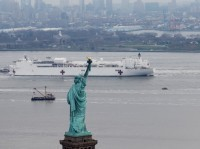 The U.S. Navy hospital ship Comfort passes the Statue of Liberty as it enters New York Harbor, March 30, 2020