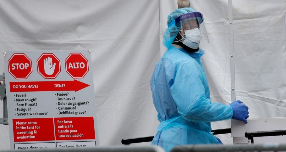 A health care worker in protective equipment enters the Brooklyn Hospital Center during the COVID-19 outbreak in Brooklyn, New York, March 31, 2020
