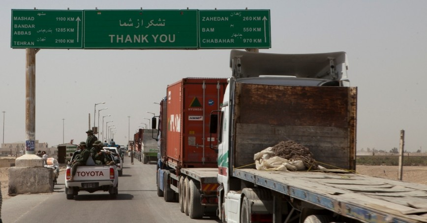 Trucks wait to cross the Afghanistan-Iran border in Zaranj, Afghanistan, May 10, 2011, photo by Sgt. Mallory VanderSchans/U.S. Marine Corps