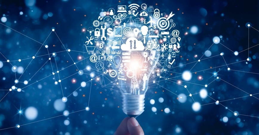 Hand holding light bulb and business digital marketing innovation technology icons, photo by ipopba/Getty Images
