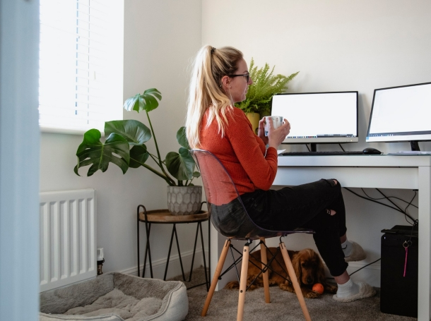 Woman working at home at a computer, photo by SolStock/Getty Images