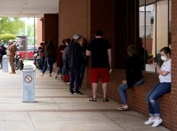People wait in line to file for unemployment following an outbreak of COVID-19 at an Arkansas Workforce Center in Fort Smith, Arkansas, April 6, 2020, photo by Nick Oxford/Reuters