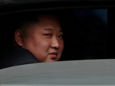 North Korea's leader Kim Jong Un sits in his vehicle after arriving at a railway station in Dong Dang, Vietnam, at the border with China, February 26, 2019, photo by Athit Perawongmetha/Reuters