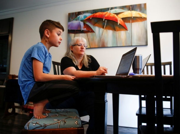 Chrissy Brackett and grandson Caidence Miller learn to navigate an online learning system at her home in Woodinville, Washington, March 11, 2020, photo by Lindsey Wasson/Reuters