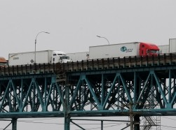 Commercial trucks cross over the Ambassador Bridge at the international border crossing during the COVID-19 outbreak, in Detroit, Michigan, March 18, 2020, photo by Rebecca Cook/Reuters