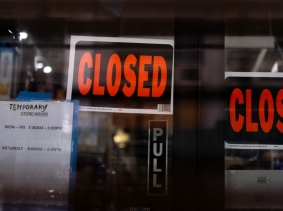Temporary closed signage is seen at a store in Manhattan following the outbreak of COVID-19, in New York City, March 15, 2020, photo by Jeenah Moon/Reuters