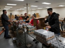Employees and volunteers prepare relief boxes at the South Texas Food Bank in Laredo, Texas, March 20, 2020, photo by Veronica Cardenas/Reuters