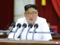 Kim Jong Un speaks during the 5th Plenary Meeting of the 7th Central Committee of the Workers' Party of Korea in this undated photo released on December 29, 2019, photo by KCNA/Reuters