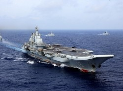 China's aircraft carrier Liaoning takes part in a Chinese People's Liberation Army Navy military drill in the western Pacific Ocean, April 18, 2018, photo by China Stringer Network/Reuters