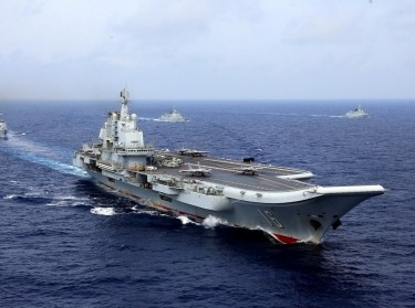 China's aircraft carrier <em>Liaoning</em> takes part in a Chinese People's Liberation Army Navy military drill in the western Pacific Ocean, April 18, 2018, photo by China Stringer Network/Reuters