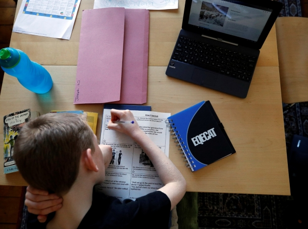 Joseph Wilkinson does schoolwork at his home in Manchester, Britain, March 23, 2020, photo by Phil Noble/Reuters
