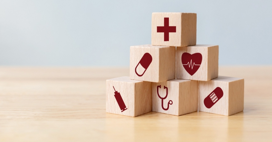Wood block stacking with icon healthcare medical, Insurance for your health concept, photo by marchmeena29/Getty Images