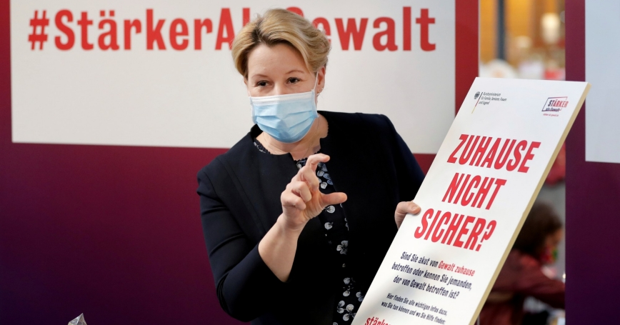 German Minister for Family Affairs, Senior Citizens, Women and Youth, Franziska Giffey speaks as she poses with a poster for a campaign against domestic violence, in a supermarket in Berlin, Germany, April 29, 2020, photo by Michael Sohn/Reuters