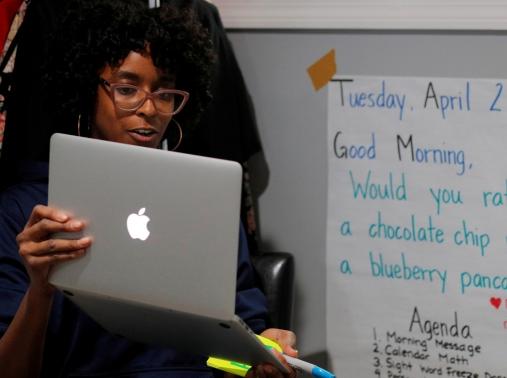 Boston Public School teacher Princess Bryant teaches her kindergarten class via video conference from her apartment in Massachusetts, April 28, 2020