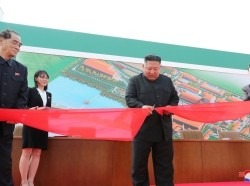 Kim Jong Un attends the completion of a fertilizer plant with his younger sister Kim Yo Jong, in a region north of Pyongyang, May 2, 2020, photo by KCNA/Reuters