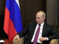Russian President Vladimir Putin attends a meeting with Syrian President Bashar al-Assad in the Black Sea resort of Sochi, Russia, May 17, 2018, p