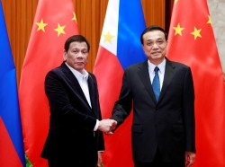 Philippine President Rodrigo Duterte (L) and Chinese Premier Li Keqiang meet in Beijing, China, August 30, 2019, photo by How Hwee Young/Pool/Reuters