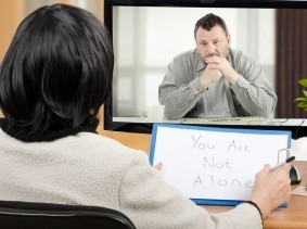 Man talks with mental health practitioner via telemedecine, photo by verbaska_studio/Getty Images