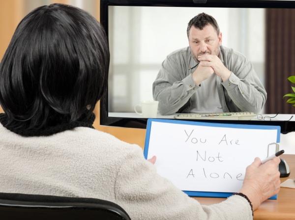Man talks with mental health practitioner via telemedecine, photo by verbaska_studio/Getty Images