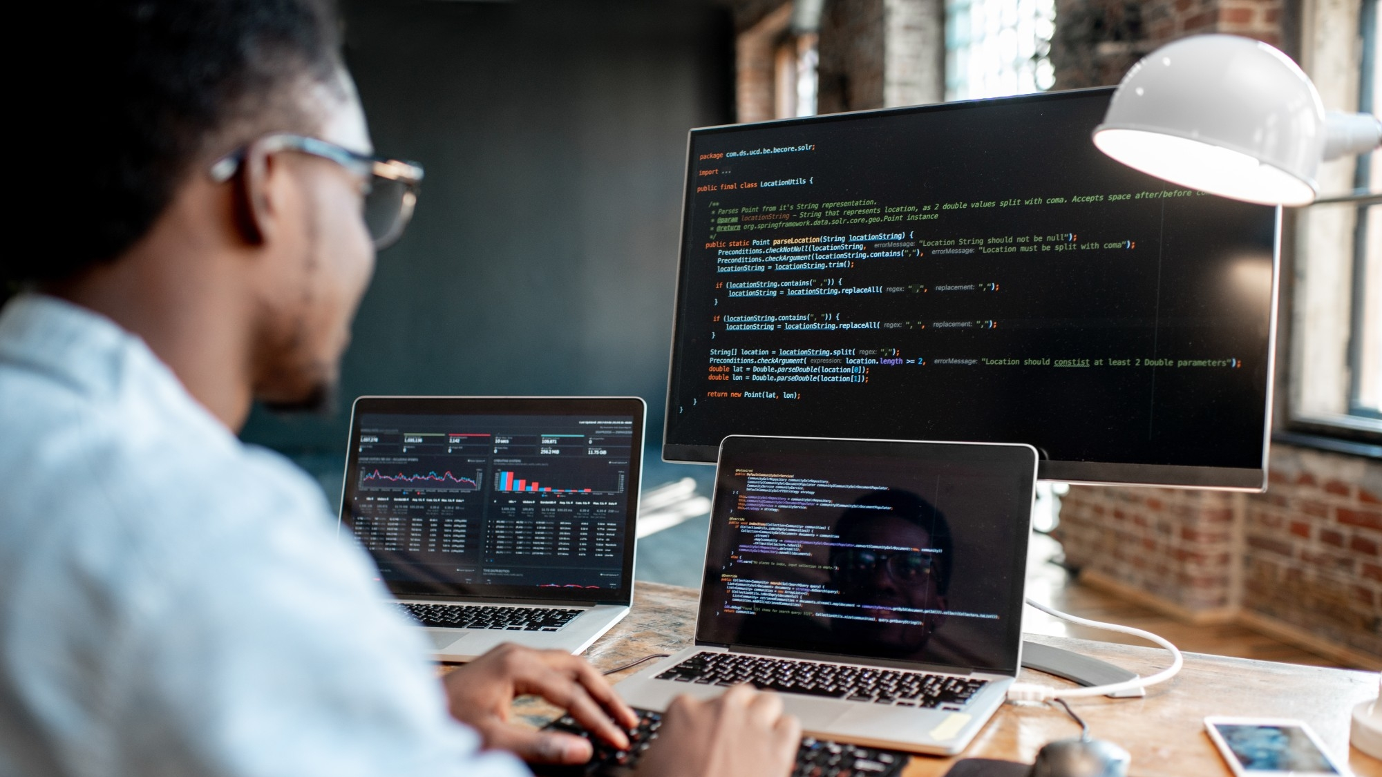 Man writing programming code, photo by RossHelen/Getty Images