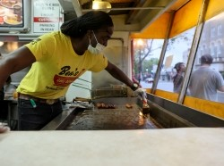 The grill is nearly empty at dinner hour at Ben's Chili Bowl during the COVID-19 pandemic in Washington, D.C., April 30, 2020, photo by Jonathan Ernst/Reuters