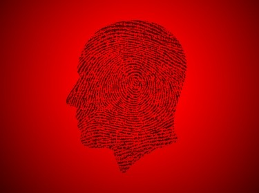 Profile with fingerprint on a red background, photo by malerapaso/Getty Images
